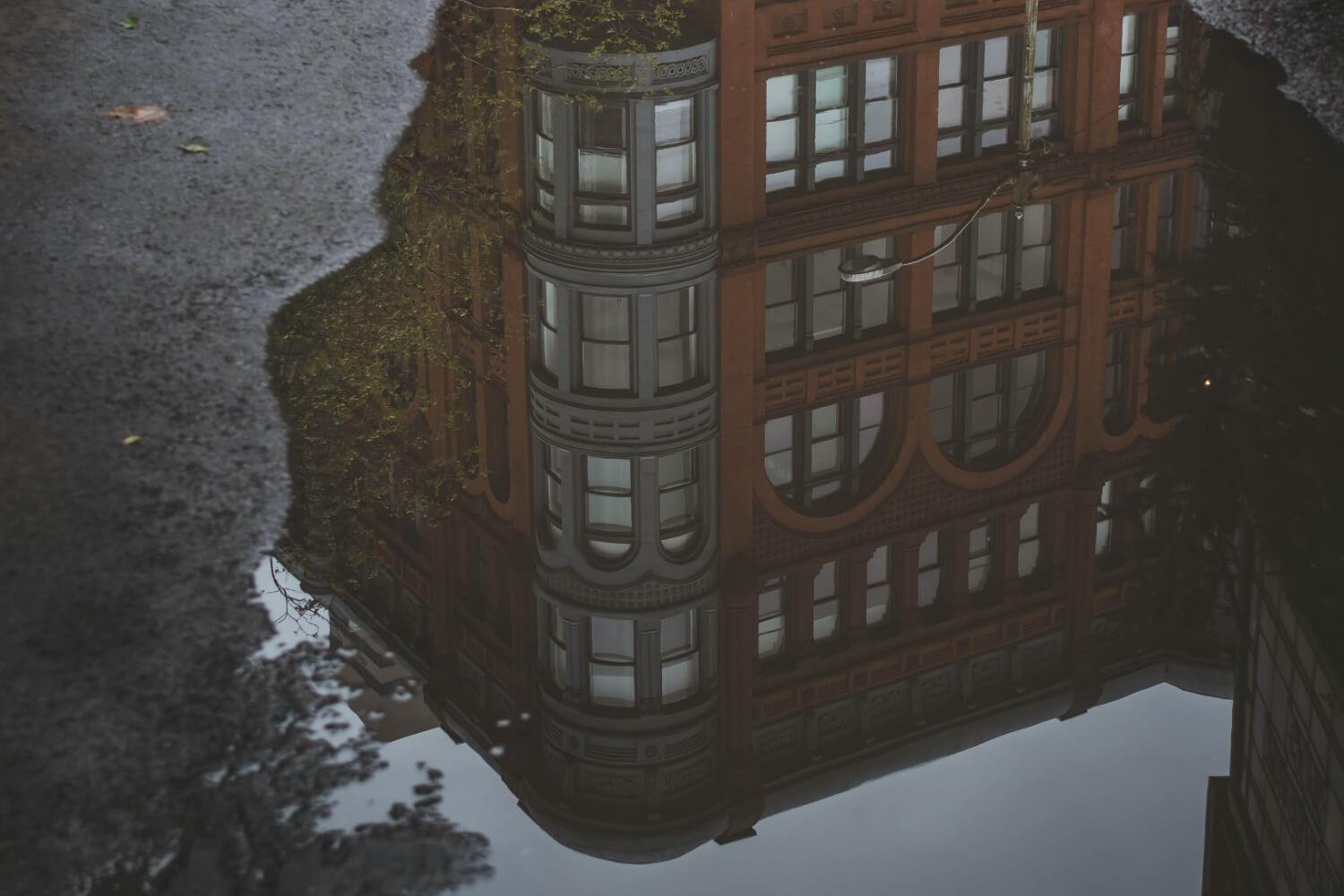 Building Reflected in a Puddle
