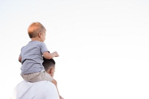 Man with child on his shoulders